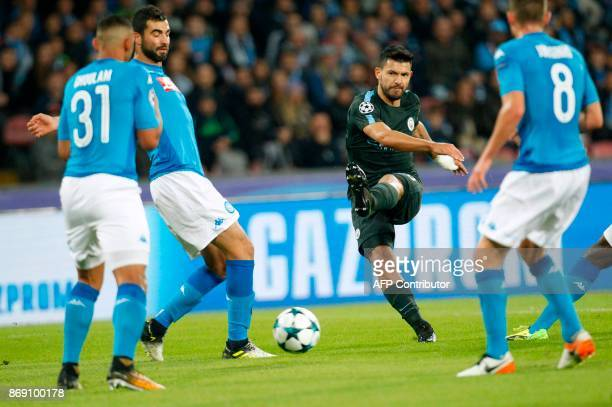 Manchester City's Argentinian striker Sergio Aguero kicks the ball during the UEFA Champions League football match Napoli vs Manchester City on...