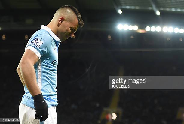 Manchester City's Argentinian striker Sergio Aguero leaves the pitch after being injured during the English Premier League football match between...
