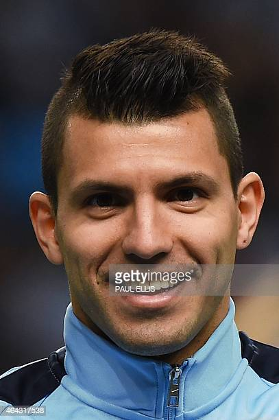Manchester City's Argentinian striker Sergio Aguero lines up for the start of the UEFA Champions League round of 16 first leg football match between...