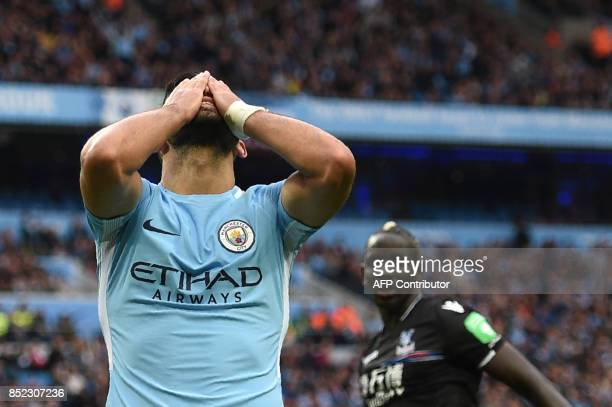 Manchester City's Argentinian striker Sergio Aguero misses a shot on goal during the English Premier League football match between Manchester City...