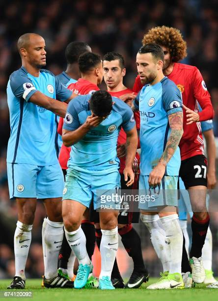 Manchester City's Argentinian striker Sergio Aguero picks himself up after going down in an altercation with Manchester United's Belgian midfielder...