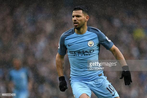 Manchester City's Argentinian striker Sergio Aguero plays in the rain during the English Premier League football match between Manchester City and...
