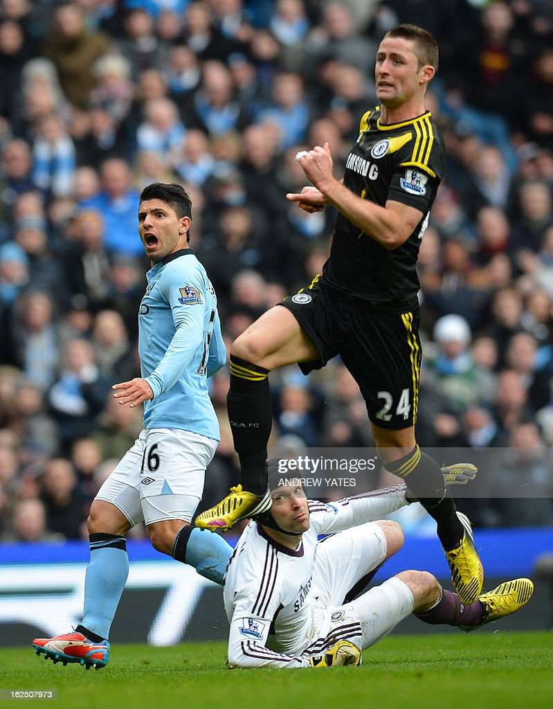 """Manchester City's Argentinian striker Sergio Aguero (L) reacts after missing a chance during the English Premier League football match between Manchester City and Chelsea at the Etihad Stadium in Manchester, northwest England, on February 24, 2013. USE. No use with unauthorized audio, video, data, fixture lists, club/league logos or """"live"""" services. Online in-match use limited to 45 images, no video emulation. No use in betting, games or single club/league/player publications."""