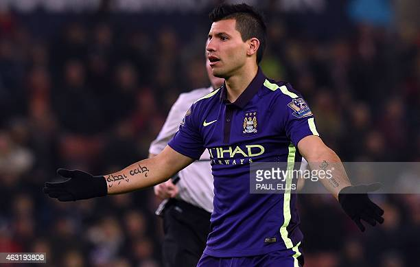 Manchester City's Argentinian striker Sergio Aguero reacts after missing a chance during the English Premier League football match between Stoke City...
