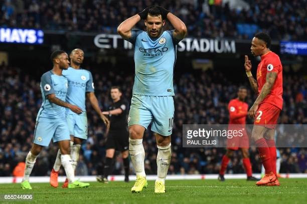 Manchester City's Argentinian striker Sergio Aguero reacts after missing a goal scoring opportunity during the English Premier League football match...