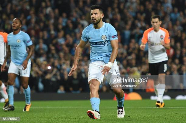 Manchester City's Argentinian striker Sergio Aguero reacts after shooting from the penalty spot but failing to score during the Group F football...