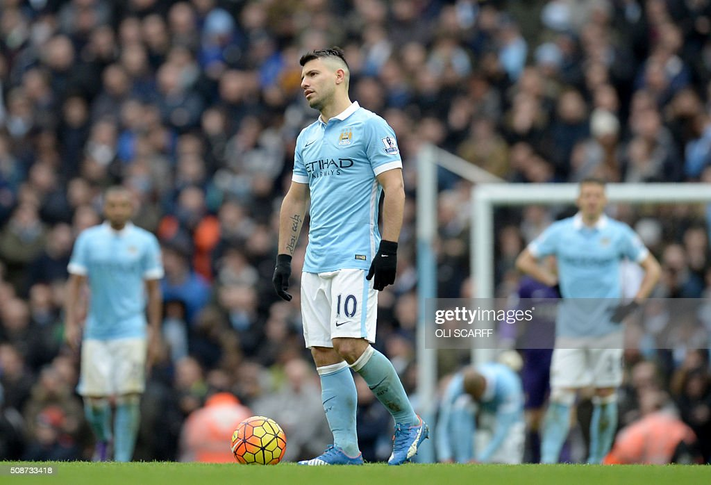 Manchester City's Argentinian striker Sergio Aguero (C) reacts after Leicester City's German defender Robert Huth (not pictured) scored his team;s third goal during the English Premier League football match between Manchester City and Leicester City at the Etihad Stadium in Manchester, north west England, on February 6, 2016. / AFP / OLI SCARFF / RESTRICTED TO EDITORIAL USE. No use with unauthorized audio, video, data, fixture lists, club/league logos or 'live' services. Online in-match use limited to 75 images, no video emulation. No use in betting, games or single club/league/player publications. /