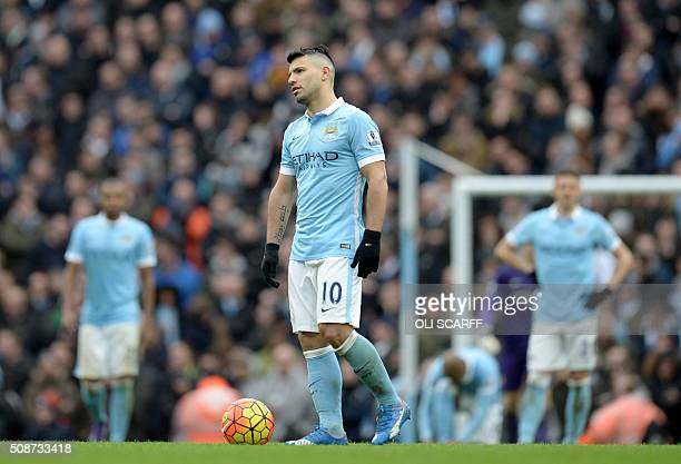 Manchester City's Argentinian striker Sergio Aguero reacts after Leicester City's German defender Robert Huth scored his team's third goal during the...