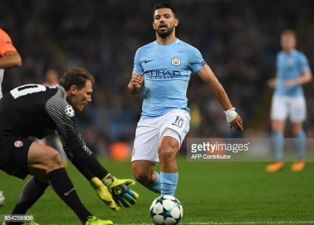 Manchester City's Argentinian striker Sergio Aguero reacts as Shakhtar Donetsk's Ukrainian goalkeeper Andriy Pyatov retreives the ball during the...