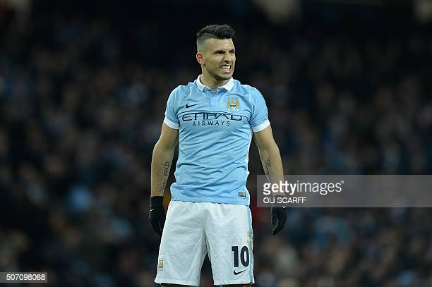 Manchester City's Argentinian striker Sergio Aguero reacts during the English League Cup semifinal second leg football match between Manchester City...
