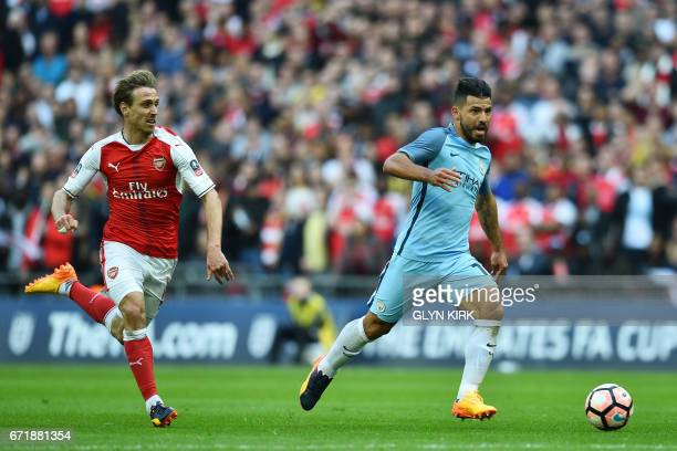 Manchester City's Argentinian striker Sergio Aguero runs past Arsenal's Spanish defender Nacho Monreal to score the opening goal during the FA Cup...