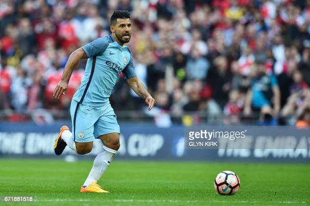 Manchester City's Argentinian striker Sergio Aguero runs to score the opening goal during the FA Cup semifinal football match between Arsenal and...