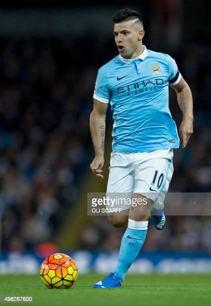 Manchester City's Argentinian striker Sergio Aguero runs with the ball during the English Premier League football match between Manchester City and...