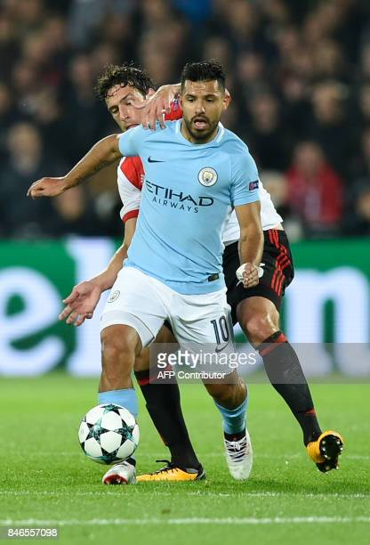 Manchester City's Argentinian striker Sergio Aguero runs with the ball during the UEFA Champions League Group F football match between Feyenoord...