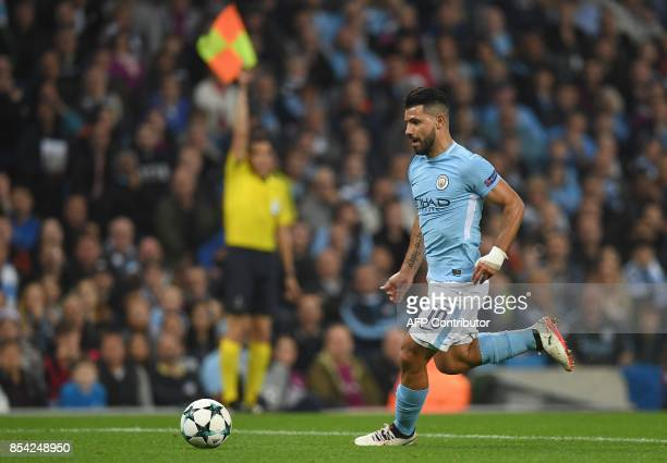 Manchester City's Argentinian striker Sergio Aguero runs with the ball towards goal but is ruled offside during the Group F football match between...