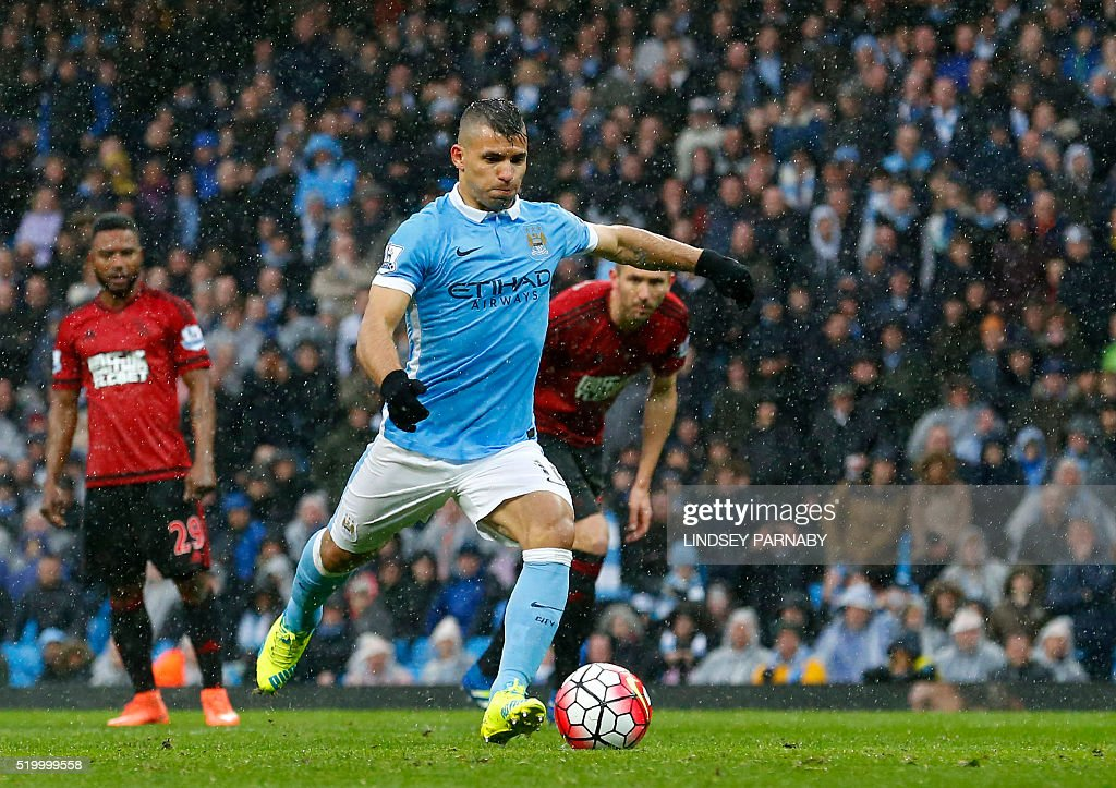 Manchester Citys Argentinian striker Sergio Aguero scores a goal during the English Premier League football match between Manchester City and West Bromwich Albion at the Etihad Stadium in Manchester, north west England, on April 9, 2016. / AFP / LINDSEY PARNABY / RESTRICTED TO EDITORIAL USE. No use with unauthorized audio, video, data, fixture lists, club/league logos or 'live' services. Online in-match use limited to 75 images, no video emulation. No use in betting, games or single club/league/player publications. /