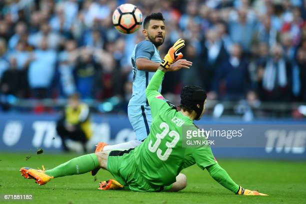 Manchester City's Argentinian striker Sergio Aguero scores the opening goal past Arsenal's Czech goalkeeper Petr Cech during the FA Cup semifinal...