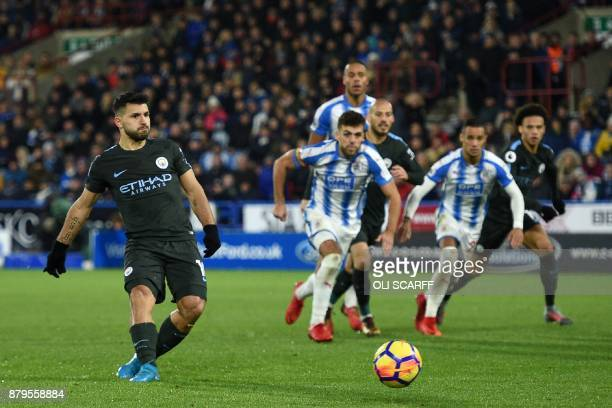 Manchester City's Argentinian striker Sergio Aguero scores their equalizer from the penalty spot during the English Premier League football match...