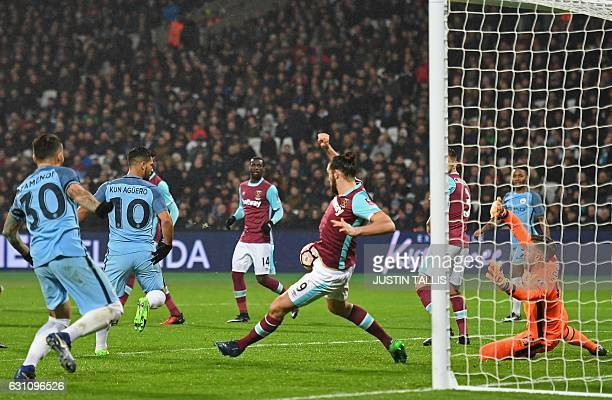 Manchester City's Argentinian striker Sergio Aguero scores their fourth goal past West Ham United's Spanish goalkeeper Adrian during the English FA...