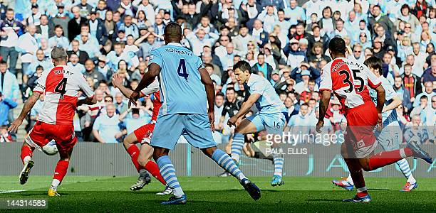 Manchester City's Argentinian striker Sergio Aguero scores their late winning goal during the English Premier League football match between...