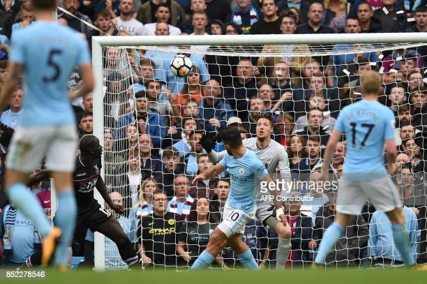 Manchester City's Argentinian striker Sergio Aguero shoots over the bar during the English Premier League football match between Manchester City and...