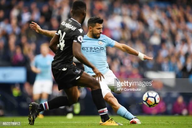 Manchester City's Argentinian striker Sergio Aguero shoots past Crystal Palace's Dutch defender Timothy FosuMensah during the English Premier League...