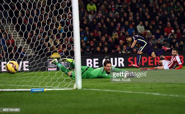 Manchester City's Argentinian striker Sergio Aguero shoots past Stoke City's Bosnian goalkeeper Asmir Begovic to score the opening goal of the...
