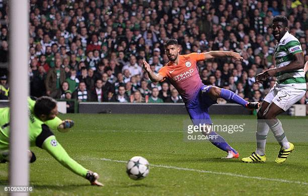 Manchester City's Argentinian striker Sergio Aguero shoots towards Celtic's Scottish goalkeeper Craig Gordon but the ball rebounds to Manchester...