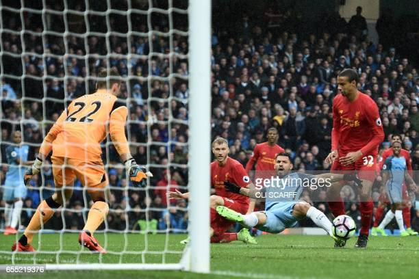 Manchester City's Argentinian striker Sergio Aguero stretches for the ball during the English Premier League football match between Manchester City...