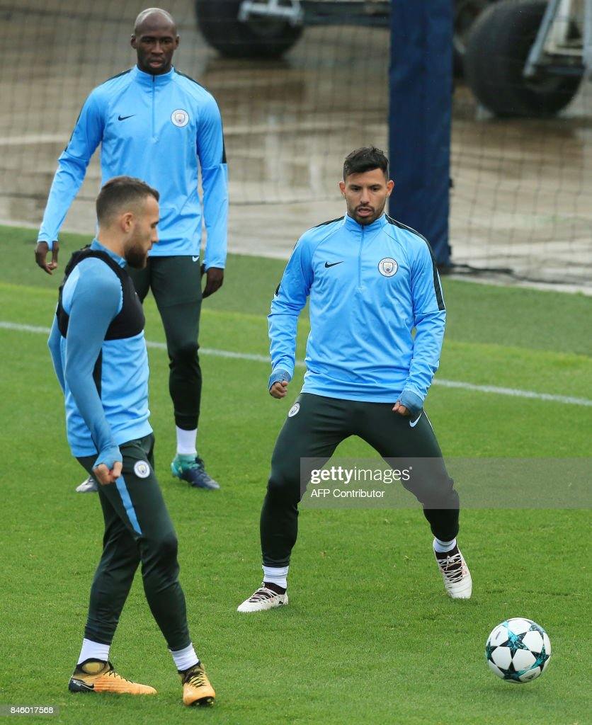 Manchester City s Argentinian striker Sergio Aguero R takes part