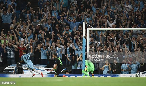 Manchester City's Argentinian striker Sergio Aguero turns to celebrate after scoring the opening goal during the UEFA Champions League group C...