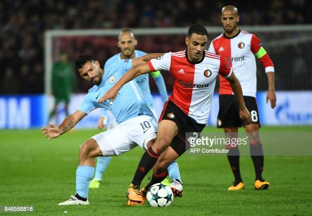 Manchester City's Argentinian striker Sergio Aguero vies for the ball with Feyenoord's Moroccan midfielder Sofyan Amrabat during the UEFA Champions...