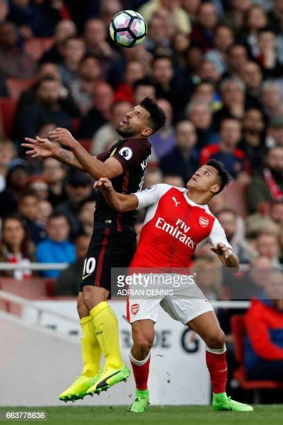 Manchester City's Argentinian striker Sergio Aguero vies with Arsenal's Chilean striker Alexis Sanchez during the English Premier League football...
