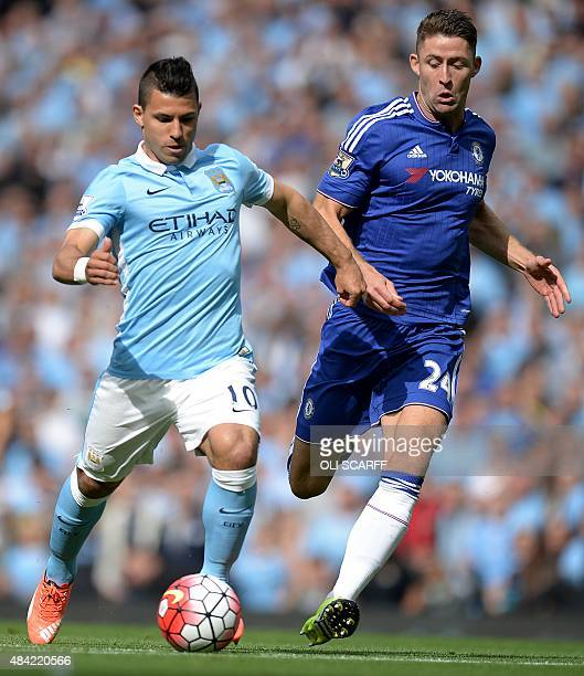 Manchester City's Argentinian striker Sergio Aguero vies with Chelsea's English defender Gary Cahill during the English Premier League football match...
