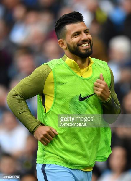 Manchester City's Argentinian striker Sergio Aguero warms up during the English Premier League football match between Manchester City and Leicester...