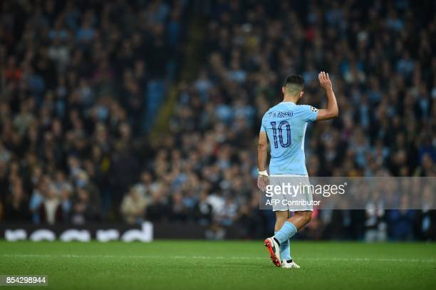Manchester City's Argentinian striker Sergio Aguero waves to the fans as he is supstituted off during the Group F football match between Manchester...