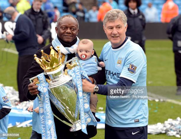 Manchester City's assistant manager Brian Kidd and Pierre Kompany with the Barclays Premier League trophy