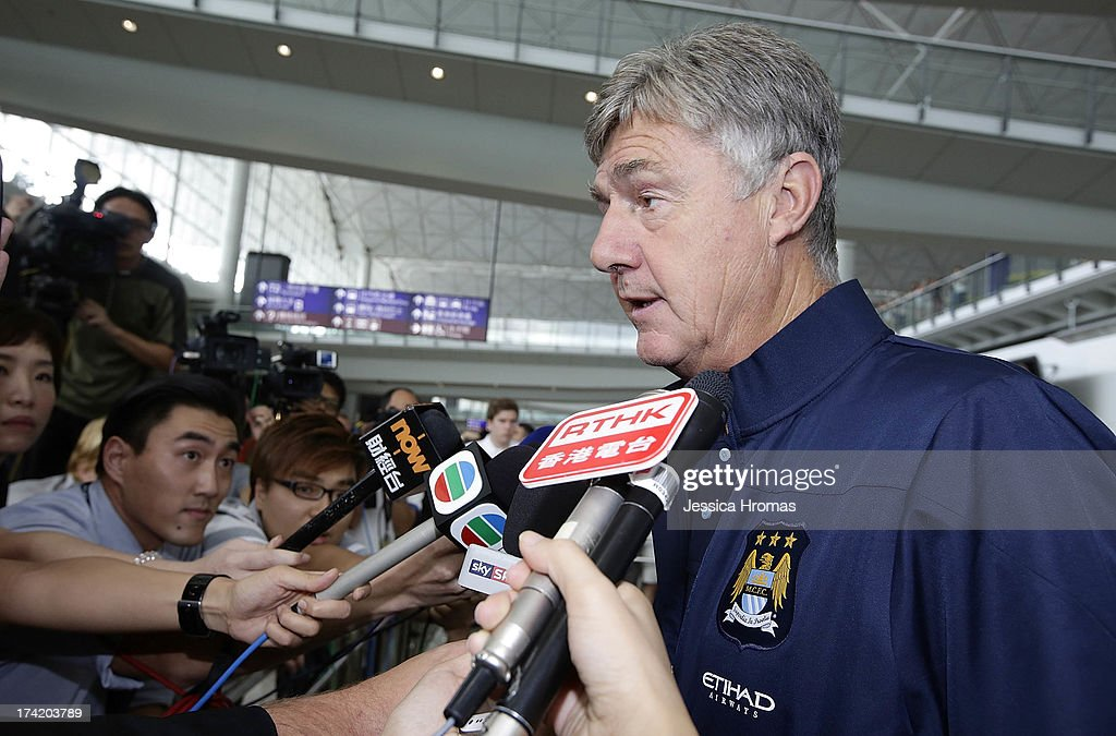 Manchester City's Assistant Manager <a gi-track='captionPersonalityLinkClicked' href=/galleries/search?phrase=Brian+Kidd&family=editorial&specificpeople=1695163 ng-click='$event.stopPropagation()'>Brian Kidd</a> speaks to the media at Hong Kong Airport after the team arrives to compete in the Barcleys Asia Trophy on July 22, 2013 in Hong Kong, Hong Kong.