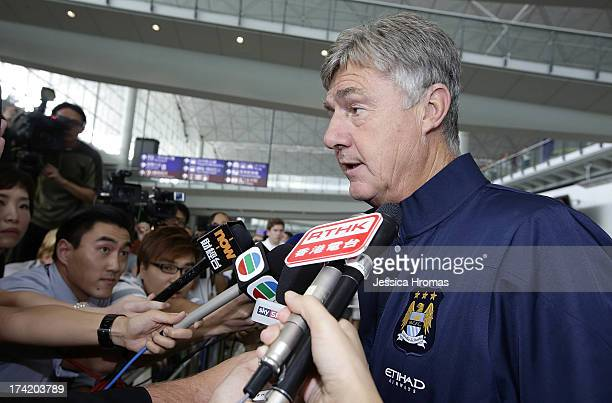 Manchester City's Assistant Manager Brian Kidd speaks to the media at Hong Kong Airport after the team arrives to compete in the Barcleys Asia Trophy...