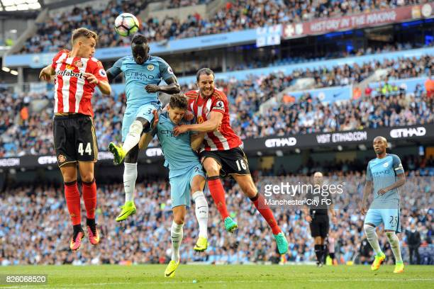 Manchester City's Bacary Sagna and John Stones and Sunderland's Adnan Januzaj and John O'Shea in action during the Barclay's Premiership match at the...