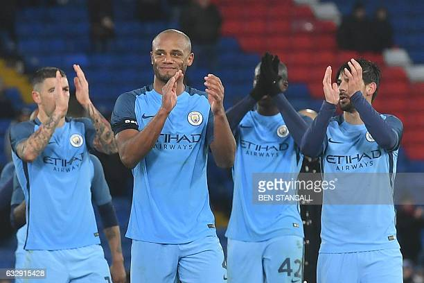 Manchester City's Belgian defender Vincent Kompany applauds with teammates at the end of the English FA Cup fourth round football match between...