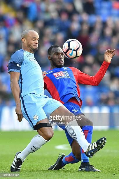 Manchester City's Belgian defender Vincent Kompany cahllenges Crystal Palace's Zaireborn Belgian striker Christian Benteke during the English FA Cup...