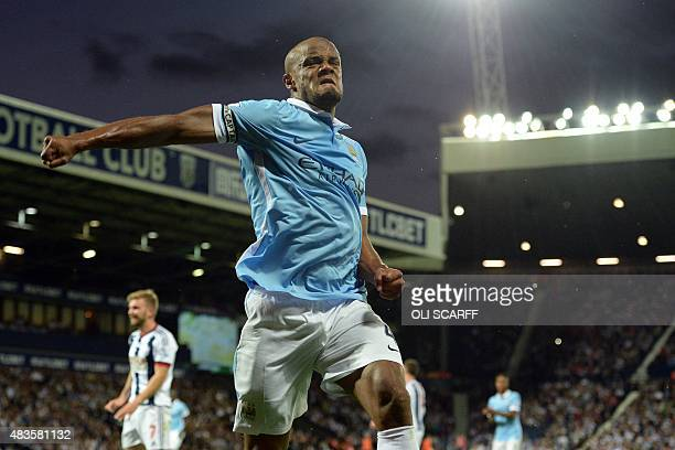 Manchester City's Belgian defender Vincent Kompany celebrates after scoring City's third goal during the English Premier League football match...