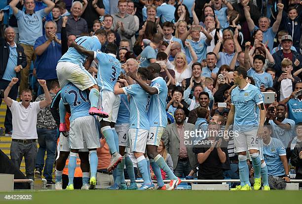 Manchester City's Belgian defender Vincent Kompany celebrates scoring their second goal with teammates during the English Premier League football...