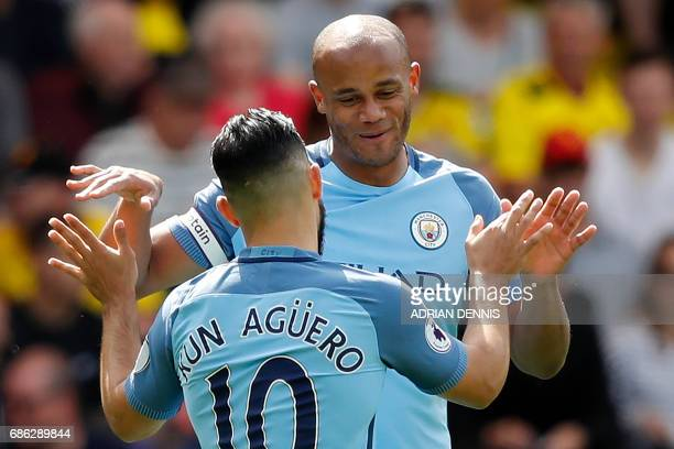 Manchester City's Belgian defender Vincent Kompany celebrates scoring his team's first goal with Manchester City's Argentinian striker Sergio Aguero...