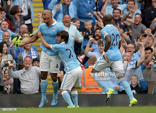 Manchester City's Belgian defender Vincent Kompany celebrates with Manchester City's Spanish midfielder David Silva after scoring their second goal...