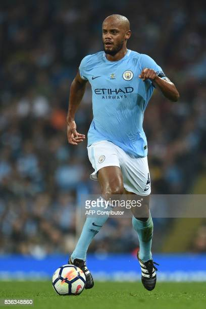 Manchester City's Belgian defender Vincent Kompany controls the ball during the English Premier League football match between Manchester City and...