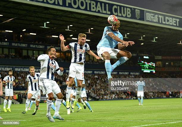 Manchester City's Belgian defender Vincent Kompany heads past West Bromwich Albion's Englishborn Scottish midfielder James Morrison to score during...