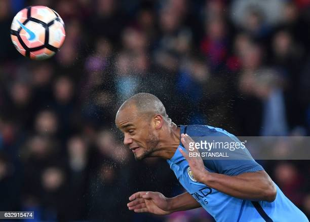 Manchester City's Belgian defender Vincent Kompany heads the ball during the English FA Cup fourth round football match between Crystal Palace and...