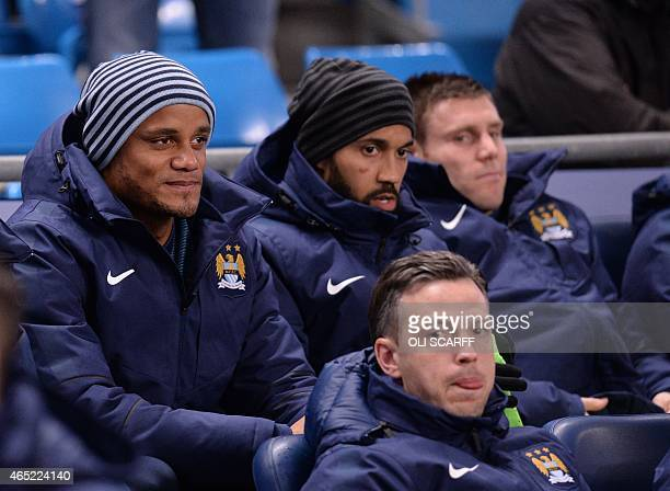 Manchester City's Belgian defender Vincent Kompany looks on from the bench ahead of the English Premier League football match between Manchester City...